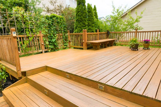Sweep your deck and remove debris trapped in between your deck boards. A simple spray of water with a garden hose can remove dirt.