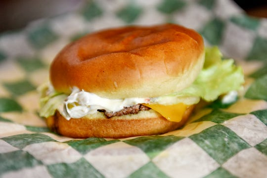 The olive burger at Weston's Kewpee Burger photographed on Tuesday, July 16, 2019, in Lansing. Owner Autumn Weston uses the same olive sauce recipe that her great-grandmother created in the 1920s.