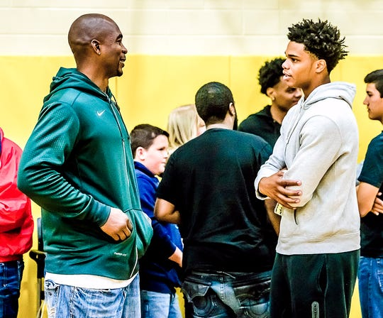 Miles Bridges, right, speaks with former MSU player and one of the original Flintstones, Antonio Smith, prior to his announcement of  his choice of college Saturday, October 3, 2015, at Mott Community College in Flint, Michigan.