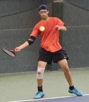 Joseph Litao hits a forehand return in the boys 14 singles final Tuesday of the 86th News Journal/Richland Bank Tennis Tournament at Lakewood Racquet Club