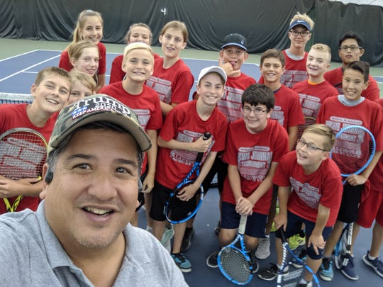 Bernie Fernandez takes a selfie with many of the junior players he has photographed during the 86th News Journal/Richland Bank Tennis Tournament at Lakewood Racquet Club