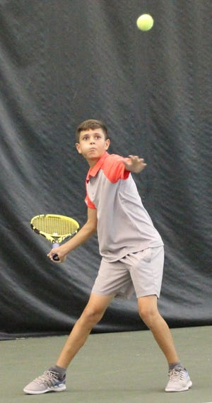 Harrison Arnholt eyes a forehand return en route to winning the boys 14 singles title Tuesday night in the 86th News Journal/Richland Bank Tennis Tournament at Lakewood Racquet Club