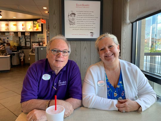 Stuart Davidson, left, and Kim Jones recall the chaos of the July 30 Walmart shooting behind their restaurant. Davidson, the restaurant operator, and Jones, the operations director, passed out chicken biscuits and water to Walmart employees who ran from the shooting.