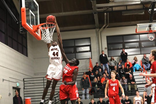 Mady Sissoko (44) goes up for a dunk in a high school basketball game for Wasatch Academy (Utah) during the 2018-19 season.