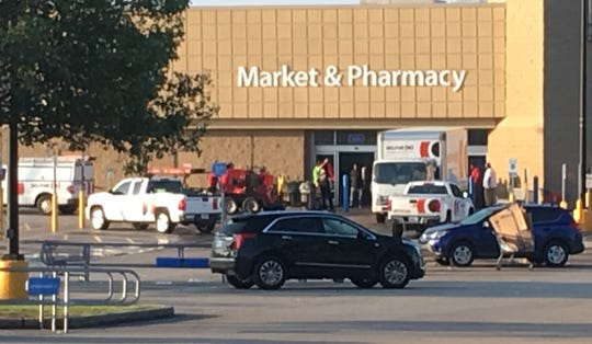 Several trucks with the logo of the company Belfor were parked near Southaven Walmart early Wednesday morning, July 31, 2019, the day following the fatal shooting.