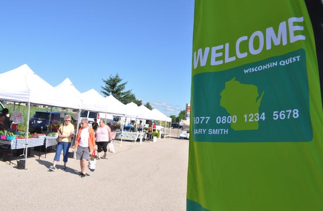 A bright green flag advertises that Quest or EBT assistance can be used at the Brown Deer Farmers Market.