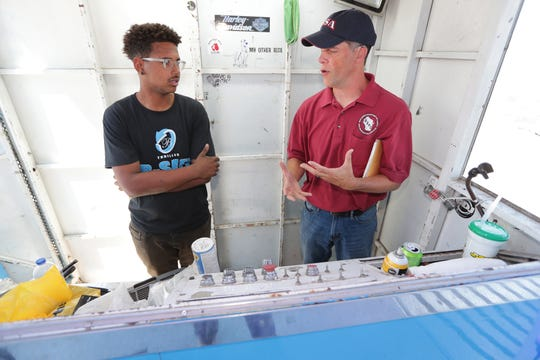 Tim Condon (right), an occupational safety inspector with the Wisconsin Department of Safety and Professional Services, talks with ride operator Robert Cubit as Condon inspects the Alpine Bobs ride at State Fair Park in West Allis on Wednesday.