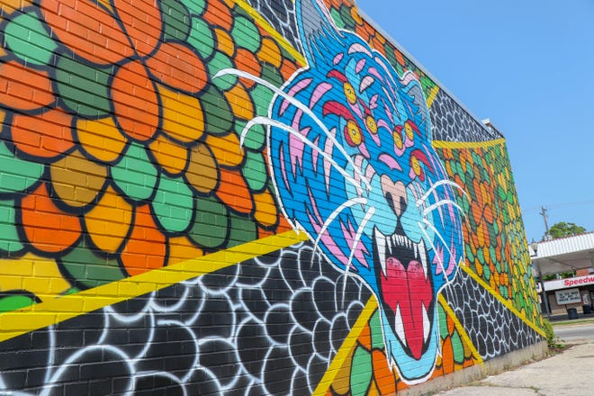 """""""Tiger Godmask"""" by Adam Hernandez was painted on the exterior of BelAir Cantina in Wauwatosa as part of the North Avenue Mural Arts District."""
