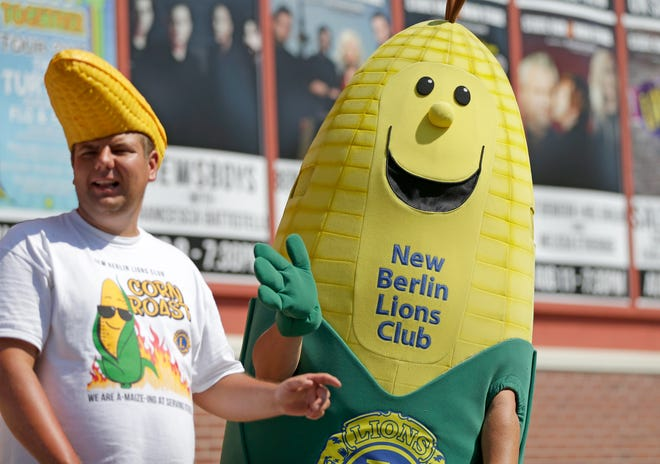 Cornelius, the New Berlin Lions Club corn mascot, waves during the daily state fair parade during the opening day of the Wisconsin State fair in 2016. The fair may have been canceled in 2020, but the corn lives on as the club plans the sale of roasted cobs during what would have been opening weekend.