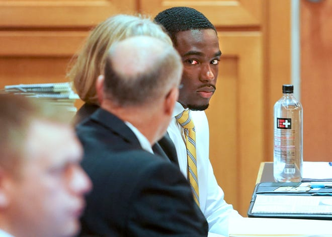 In this Tuesday, July 30, 2019 photo, former University of Wisconsin football player Quintez Cephus, right, watches during his sexual assault trial at the Dane County Courthouse in Madison, Wis. The 21-year-old Cephus is charged with second- and third-degree sexual assault after two 18-year-old women reported to police that he had assaulted them on the same night in April 2018.