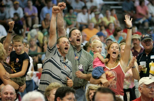 The Whitley family, of Sturtevant, reacts as bidding reaches a record level during the Governor's Blue Ribbon Livestock Auction at the Wisconsin State Fair in 2005. Metcalfe Sentry Foods bid $58,500 for the steer, breaking the old record of $58,000 set in 2003. This year's grand champion steer netted $47,500 thanks to Meijer.
