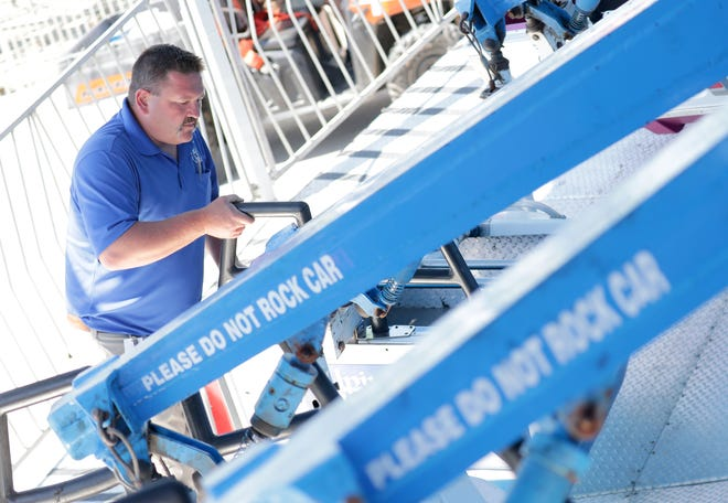 Jim Creegan, an occupational safety inspector with the Wisconsin Department of Safety and Professional Services, inspects the Alpine Bobs ride at the State Fair Park in West Allis on Wednesday. Preparations were underway for the 2019 Wisconsin State Fair, which started Thursday and runs through Aug. 11.
