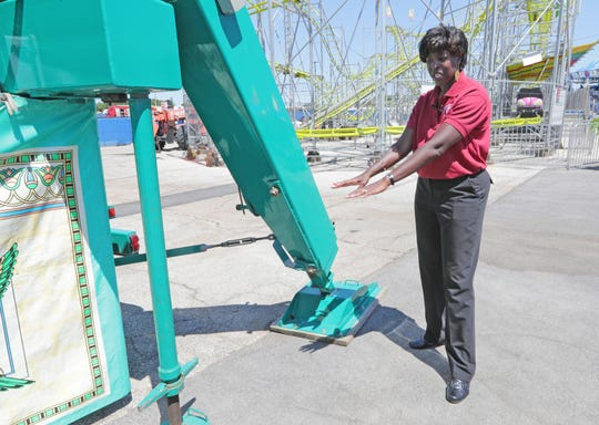 Dawn Crim, secretary of the Wisconsin Department of Safety and Professional Services discusses what's involved in inspecting rides near the Pharaoh's Fury ride at the State Fair Park in West Allis on Wednesday. Preparations were underway for the 2019 Wisconsin State Fair.