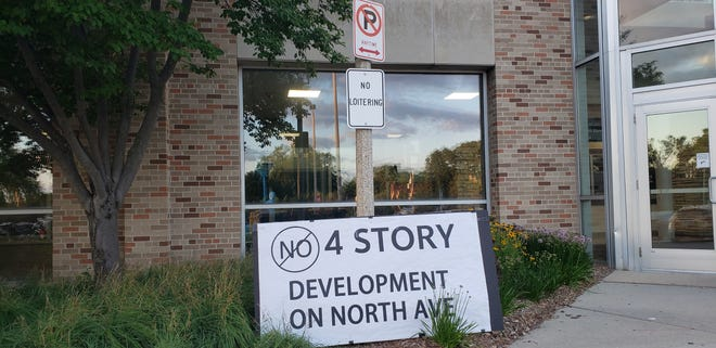 A protest sign sits next to Wauwatosa City Hall on July 30.  The Common Council voted on 6 in favor of keeping new developments in Mid Tosa at four stories.