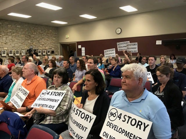 Wauwatosa residents showed creativity and persistence during the July 30 Community Affairs meeting at Wauwatosa City Hall. Many opposed changing the zoning for Midtown Tosa to allow for more than three stories on developments.