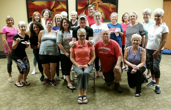 Students and family celebrated Tony Khayat's (center, wearing black shirt) 77th birthday Monday at the Baxter County Library. Khayat has raised over $60,000 for the library over the 25 years he has taught classes there.