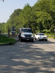 Morris County road crew sweeps Lakeside Boulevard near the entrance to Hopatcong State Park in Roxbury. July 31, 2019