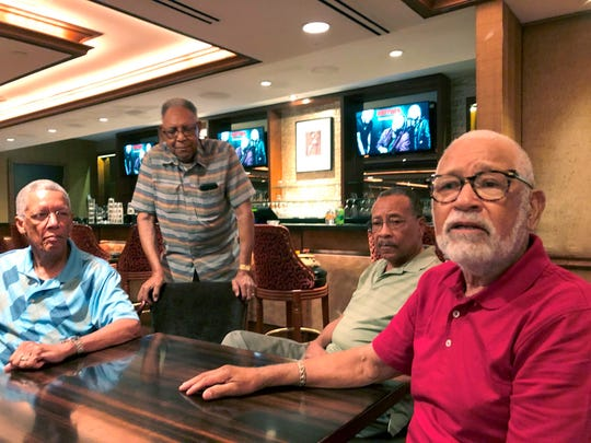 Frederick Davis, left, and his brothers Eddie, second left, Julius, second right, and Octavious speak with a reporter during a family reunion at a hotel-casino.