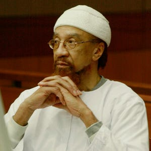 Jamil Abdullah Al-Amin, formerly known as H. Rap Brown, watches during the sentencing portion of his trial in Atlanta.