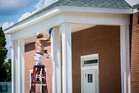 Contractors put the finishing touches on Parson Mortuary's new crematory on W. Adams Street in downtown Muncie.