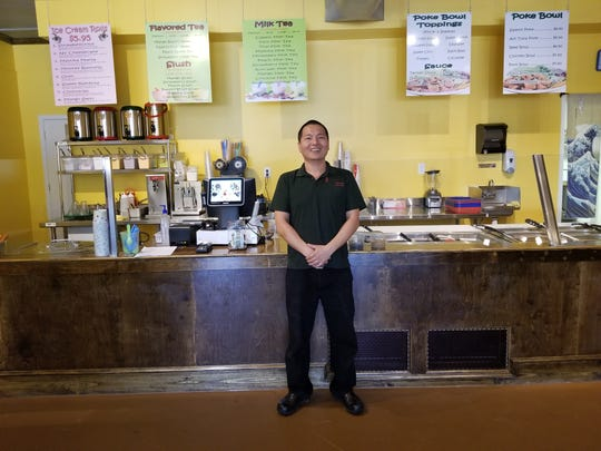 Ricky Lin, eZone owner, at his latest Dickson restaurant, which serves rolled ice cream, poke bowls, and milk teas.