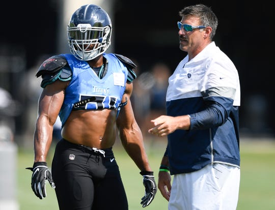 Titans defensive end Cameron Wake (91) talks with head coach Mike Vrabel during practice at Saint Thomas Sports Park Wednesday, July 31, 2019, in Nashville, Tenn.