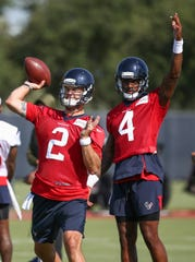 Week 17: Dec. 29, noon, Titans at Texans -- Houston Texans quarterback AJ McCarron (2) throws the ball July 25, 2019, as quarterback Deshaun Watson (4) watches during training camp at Houston Methodist Training Center.