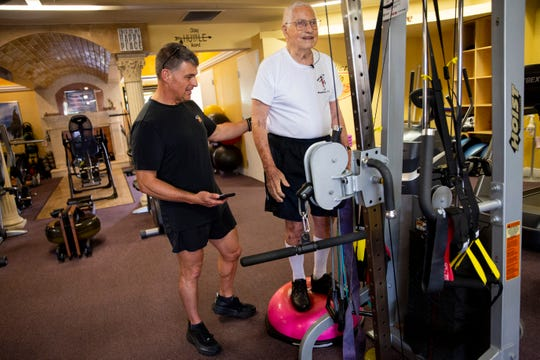 Richard Niess, 96, stands on a BOSU ball to work on his balance with Jon Bates at Addicted to Fitness in Naples on Wednesday, July 31, 2019. For his 90th birthday, Niess balanced on the BOSU ball while throwing a medicine ball back and forth with Bates 90 times in a row.
