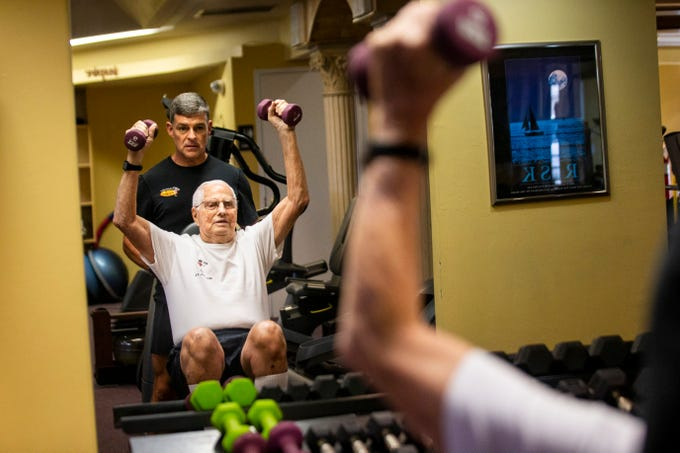 Richard Niess, 96, lifts weights with Jon Bates at Addicted to Fitness in Naples on Wednesday, July 31, 2019. Niess has been working out with Bates for the past 16 years. ÒIf you want to stay alive, you gotta do it,Ó Niess said. ÒOtherwise, IÕm sure youÕd be pushing up daisies.Ó