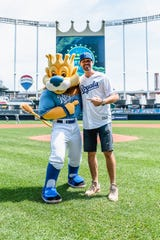 Comedian Jeff Dye poses with Sluggerrr, the Kansas City Royals mascot, earlier this summer.