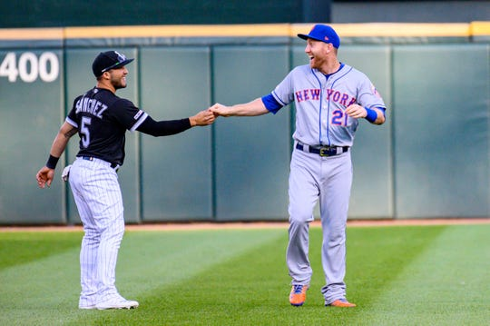 Jul 30, 2019; Chicago, IL, USA; Chicago White Sox second baseman Yolmer Sanchez (5) and New York Mets third baseman Todd Frazier (21) greet prior to a game at Guaranteed Rate Field.