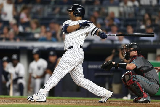 Edwin Encarnacion #30 of the New York Yankees hits a RBI double to center field in the sixth inning against the Arizona Diamondbacks at Yankee Stadium on July 30, 2019 in New York City.