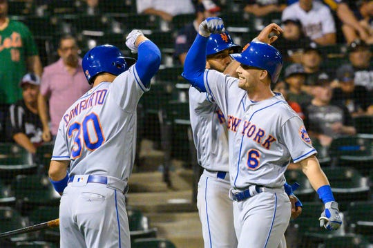 Jul 30, 2019; Chicago, IL, USA; New York Mets right fielder Jeff McNeil (6) celebrates his two-run home run with shortstop Amed Rosario (behind) and center fielder Michael Conforto (left) during the eleventh inning against the Chicago White Sox at Guaranteed Rate Field.