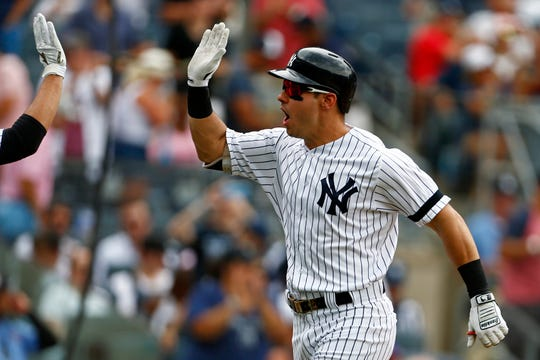 New York Yankees left fielder Mike Tauchman (39) reacts after hitting a two run home run against the Arizona Diamondbacks during the second inning at Yankee Stadium. Sports