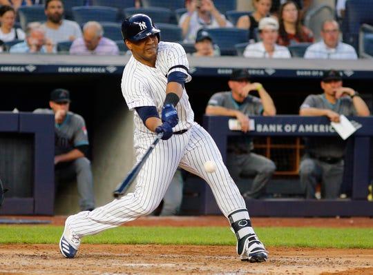 Jul 30, 2019; Bronx, NY, USA; New York Yankees designated hitter Edwin Encarnacion (30) singles against the Arizona Diamondbacks during the third inning at Yankee Stadium.