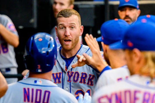 Jul 30, 2019; Chicago, IL, USA; New York Mets third baseman Todd Frazier (21) celebrates with teammates in the dugout after scoring a run during the second inning against the Chicago White Sox at Guaranteed Rate Field.