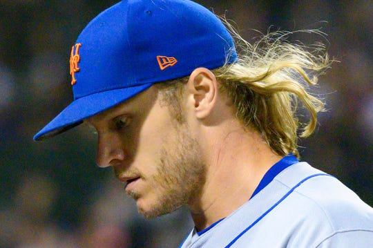 Jul 30, 2019; Chicago, IL, USA; New York Mets starting pitcher Noah Syndergaard (34) looks down after ending the seventh inning against the Chicago White Sox at Guaranteed Rate Field.