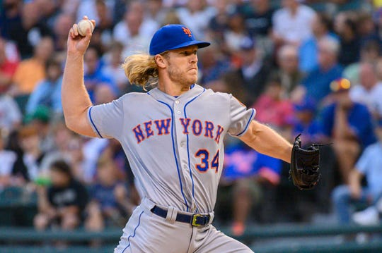 Jul 30, 2019; Chicago, IL, USA; New York Mets starting pitcher Noah Syndergaard (34) pitches during the first inning against the Chicago White Sox at Guaranteed Rate Field.