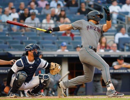 Jul 30, 2019; Bronx, NY, USA; Arizona Diamondbacks left fielder David Peralta (6) singles against the New York Yankees during the first inning at Yankee Stadium.