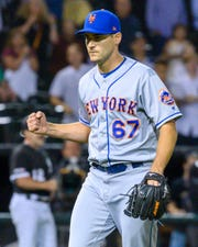 Jul 30, 2019; Chicago, IL, USA; New York Mets relief pitcher Seth Lugo (67) reacts after ending the eighth inning against the Chicago White Sox at Guaranteed Rate Field.