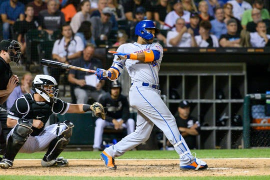 Jul 30, 2019; Chicago, IL, USA; New York Mets second baseman Robinson Cano (24) grounds into sacrifice RBI during the fifth inning against the Chicago White Sox at Guaranteed Rate Field.