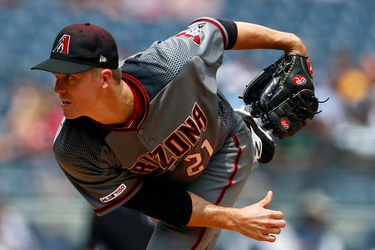 Jul 31, 2019; Bronx, NY, USA; Arizona Diamondbacks pitcher Zack Greinke (21) pitches against the New York Yankees during the first inning at Yankee Stadium.