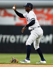 Jul 31, 2019; Bronx, NY, USA; New York Yankees shortstop Didi Gregorius (18) reacts after injuring himself against the Arizona Diamondbacks during the fourth inning at Yankee Stadium.