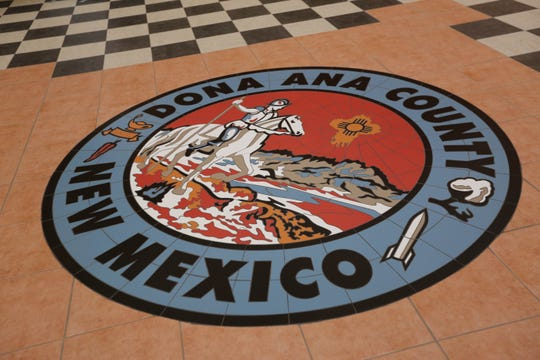The Doña Ana County seal is pictured  during a meeting on Tuesday, June 25, 2019.