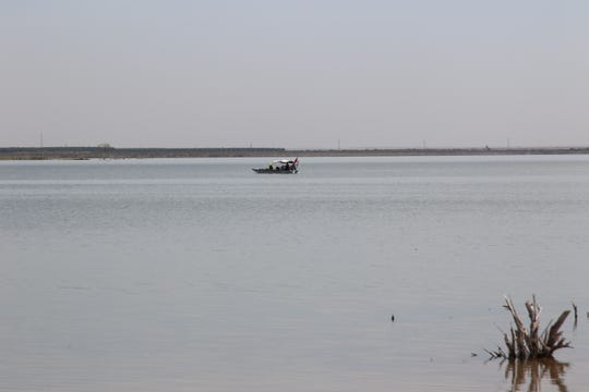 A New Mexico State Police rescue boat combs the waters of Brantley Lake State Park near Carlsbad July 31 for a possible drowning victim.