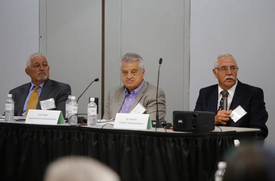 From left, Leo Baca, John Badal and Joe Hausner participate in a panel discussion about telecommunications on tribal lands during the Rural Networks Conference on July 31 at San Juan College in Farmington.