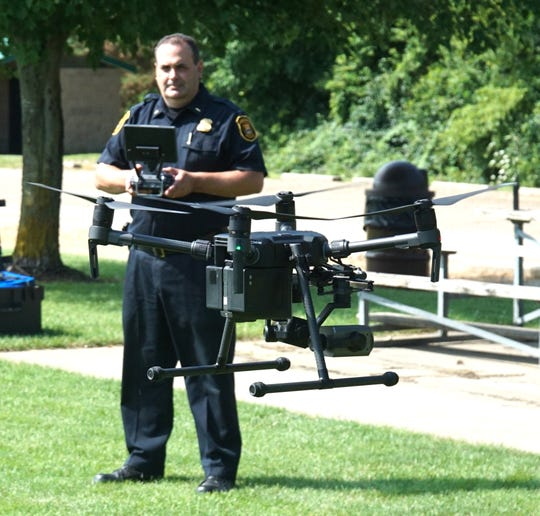 Lt. Paul Nicholas flies the Farmington Hills Police Department's Matrice 210 drone. The department spent about $25,000 on two drones and the cameras required some months ago. The officers that operate the drones must be certified by the FAA and only use them within certain altitude limits.                                                           This drone, once airborne, has about a 30 minute flight limit.
