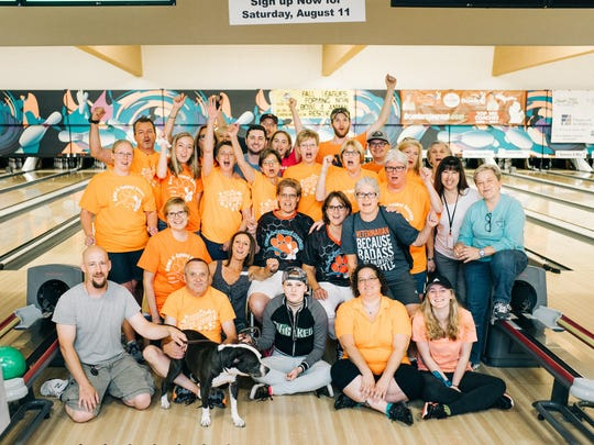 Bowlers pose together at the Bowl-4-Animal Rescue event in Farmington last year.