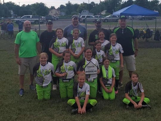 The Livonia Wild 10U Benaske team poses with their medals.