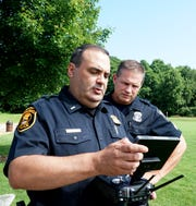 Farmington Hills Police Lt. Paul Nicholas, left, and Sgt. Doug Muller take a look at the control panel for one of the department's two drone aircraft on July 31, 2019. The pair were out in in the township training on the aircraft that day.